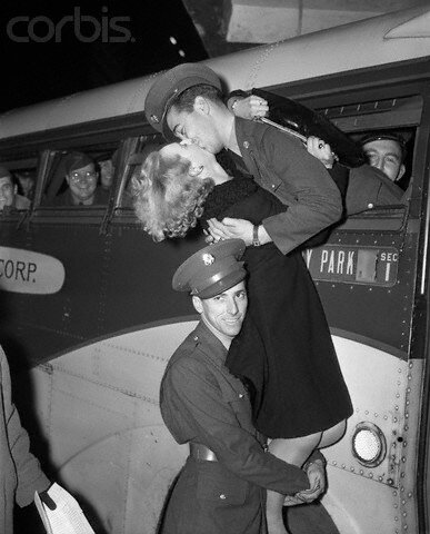 Soldier Holds Up A Girl To Kiss Soldier