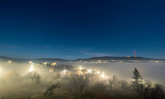 A photo made available on 28 December 2015 shows a starry sky above the fog-covered city of Pecs fro