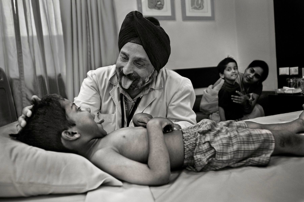 Novartis Annual Report 2009, Page 14, Sikh Doctor with sick boy and his family, Fortis Hospital, Delhi, India, 2008