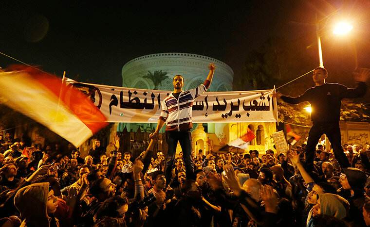 Protesters chant slogans in front of the presidential palace in Cairo