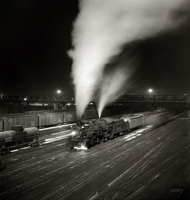 """March 1943. Argentine, Kansas. """"Freight train about to leave the Atchison, Topeka & Santa Fe Railroad yard for the West Coast."""""""