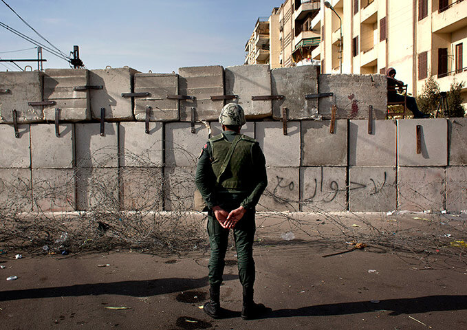 A soldier stands guard in front of the presidential palace