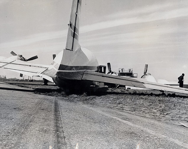 Skid marks show the path of a DC-6 airliner that crashed at LaGuardia when it lost its right main gear while making a landing; passengers were uninjured