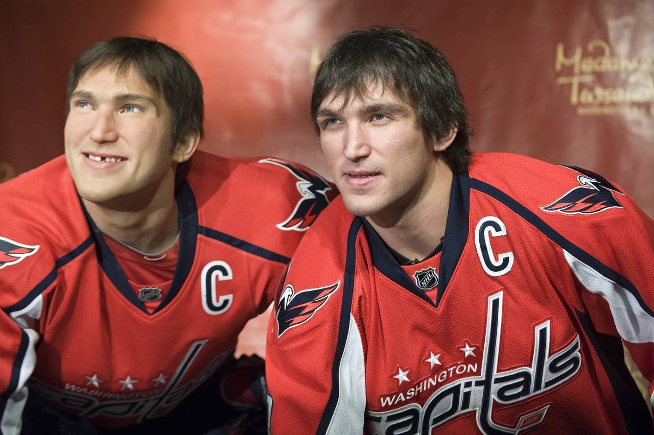 Ovechkin mimics his wax likeness in hockey gear during the unveiling at Madame Tussauds wax museum in Washington