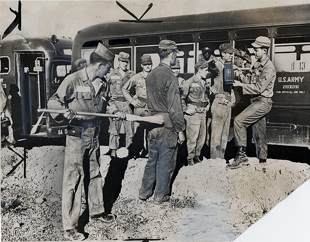 Soldiers are routinely checked for contamination and swept for radioactive dust following an A-bomb test in the Nevada desert