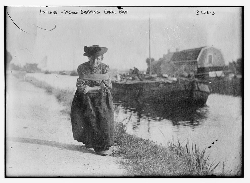Holland -- woman drawing canal boat.