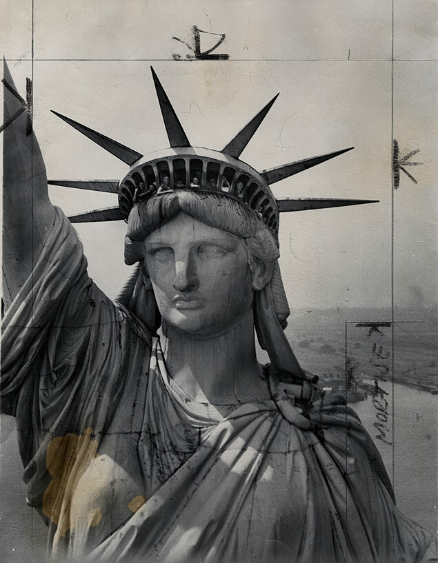 Visitors look out from the crown atop the face of the Statue of Liberty