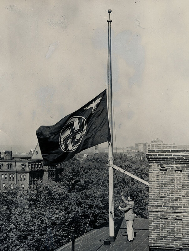 The German flag is flown at half staff atop the embassy in Washington, D.C., to mourn the loss of the zeppelin Hindenburg and its victims 1937