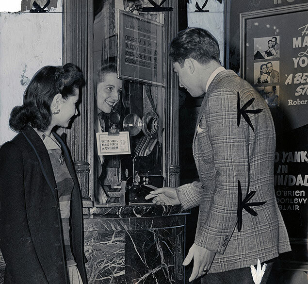 The gentleman assumes the burden of purchasing the tickets for the evening's entertainment 1943-05-11