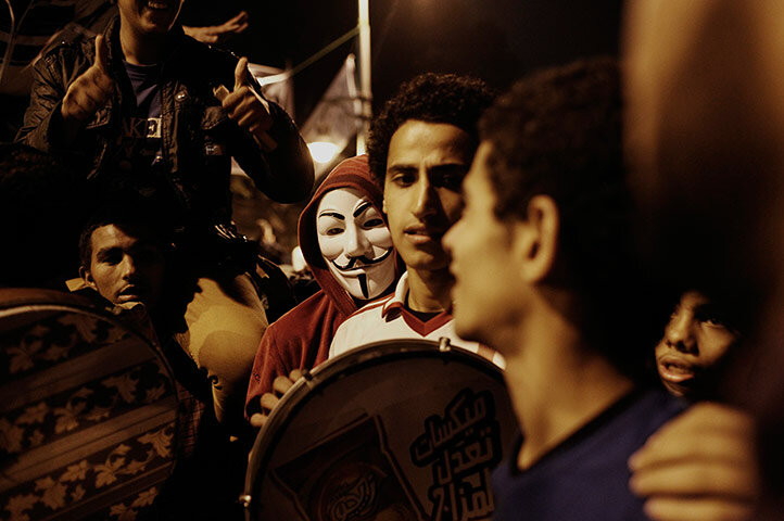 An Egyptian man wearing an 'Anonymous' mask takes part in a demonstration
