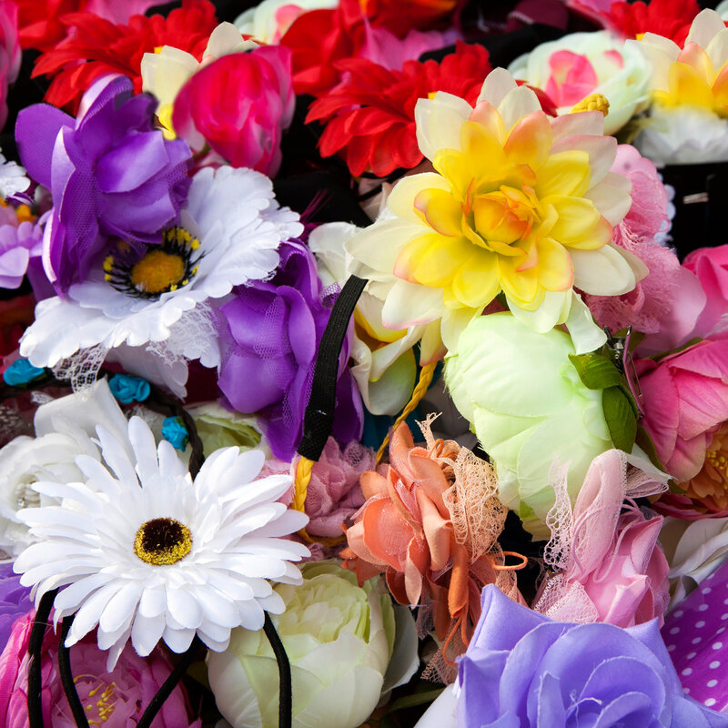 Bright flowers  background. Vintage, handmade sewing flowers.