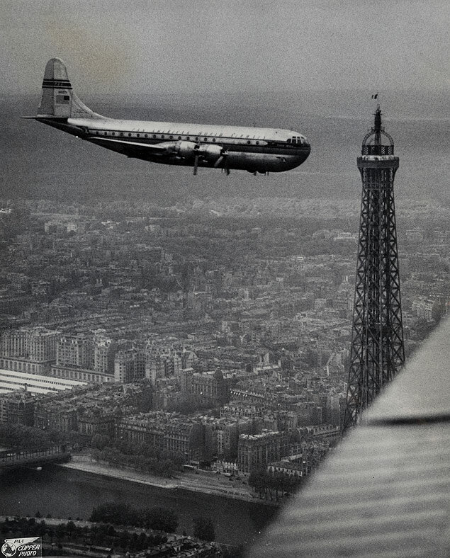 PanAm's latest airplane, the Clipper America, flies over the Eiffel Tower on its first flight to Paris