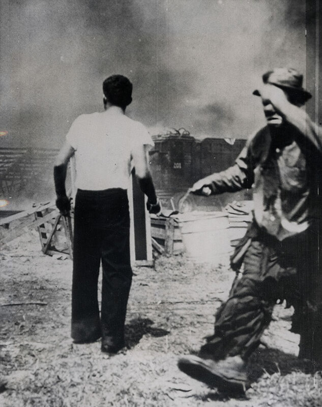 Clown Emmett Kelly joins the crew in battling a fire which destroyed the big top tent of the Ringling Brothers Barnum & Bailey Circus at Hartford, Connecticut 1944.
