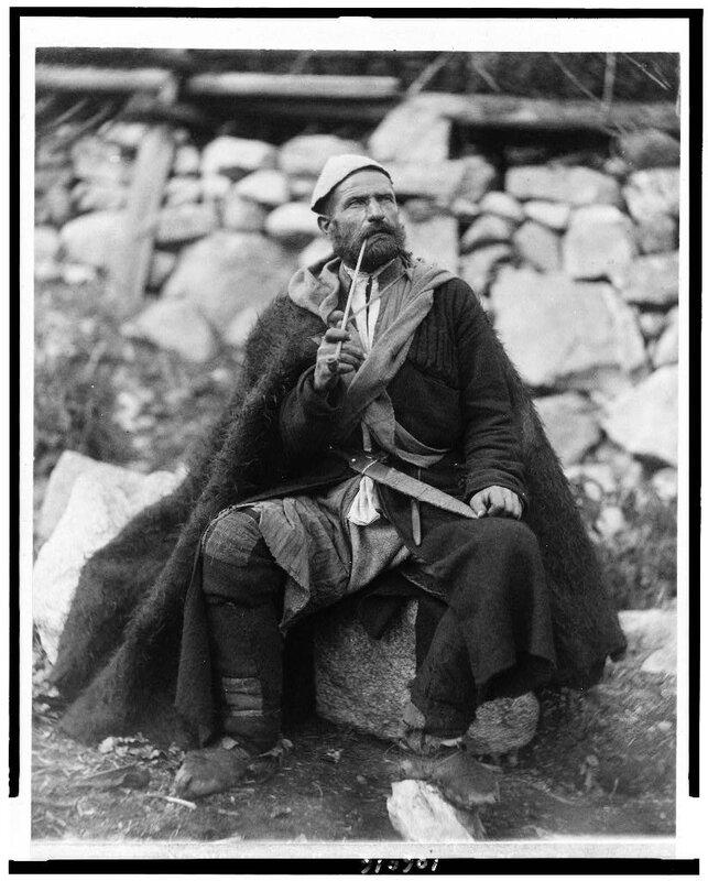 Old peasant with dagger and long smoking pipe, Mestia, Svanetia, Georgia (Republic).