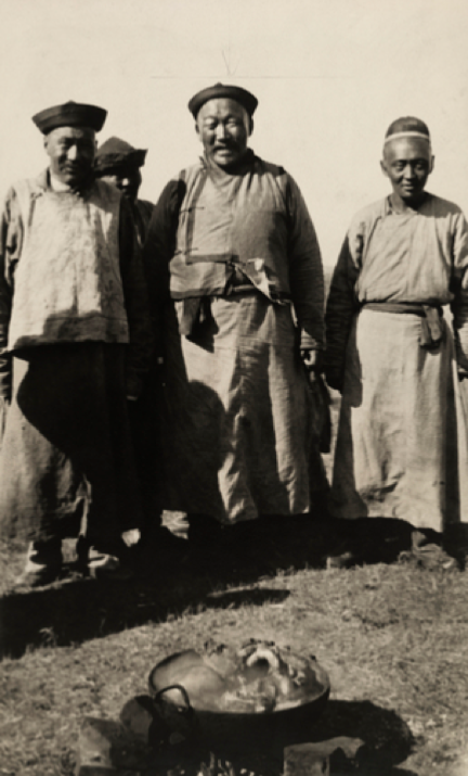 Mongolian men standing over a pot of food being cooked, 1921. Photo by Eugene Lee Stewart.