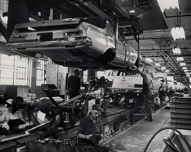 Working on the assembly line in the Chrysler Corporation plant in Detroit, Michigan.jpg