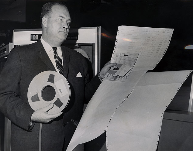 City Police Commissioner displays tabulated fingerprinting results retrieved from magnetic tape storage on the IBM 1401 computer.jpg