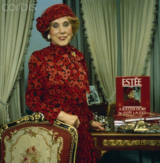 Estee Lauder with Copies of Her Book
