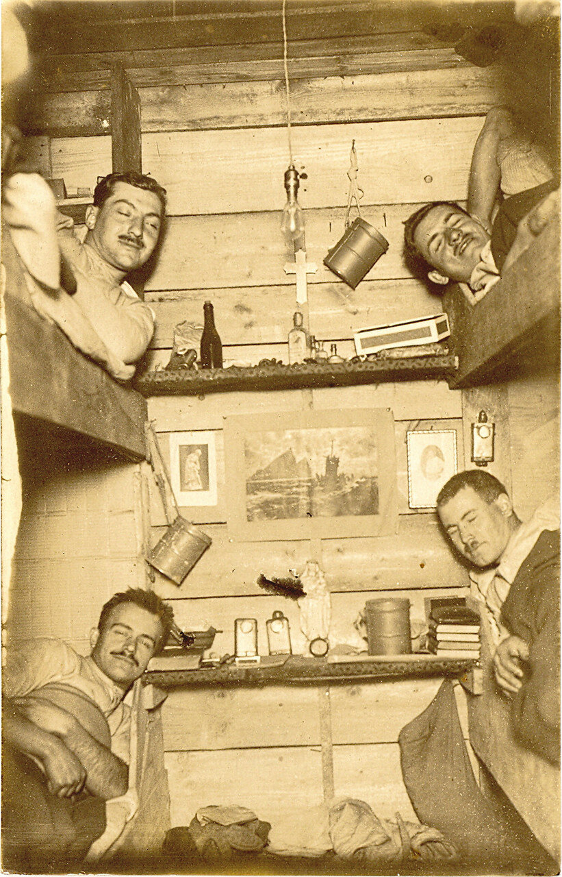 Four German soldiers in bunk beds who had been woken up for a surprise photograph during World War I; ca. 1917..jpg