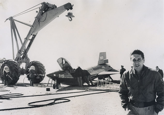 Pilot Scott Crossfield walks away from his damaged X-15 after an emergency landing at Edwards Air Force Base, California