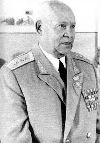Л. Бауков