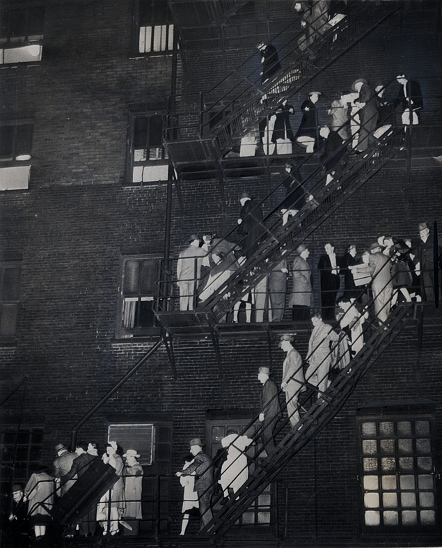 Guests use the fire escape to get away from the flames destroying the Hotel LaSalle in Chicago, Illinois
