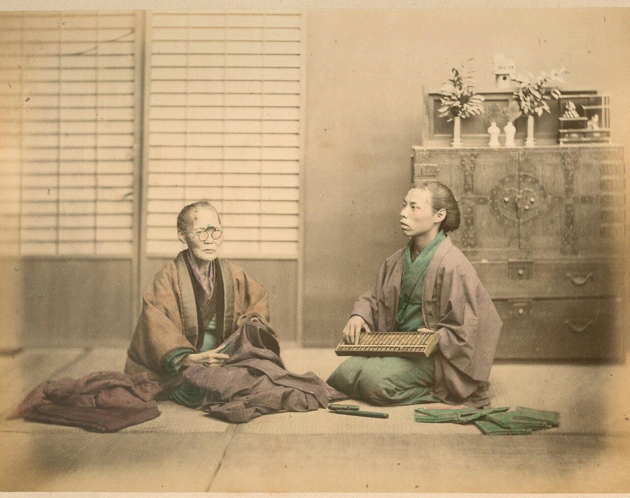 Торговец тканями с помощником. 1875