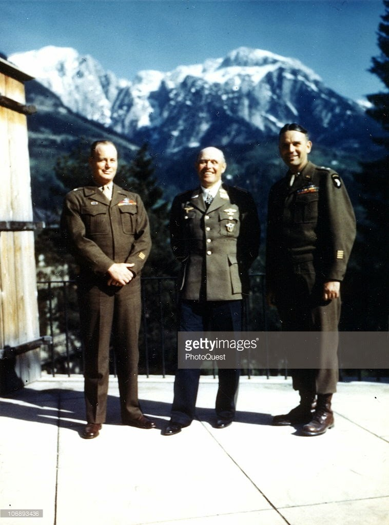 German Field Marshal Albert Kesselring (1881 - 1960) (center) who motored into Berchtesgarden and surrendered to Major General Maxwell D. Taylor smiling.jpg