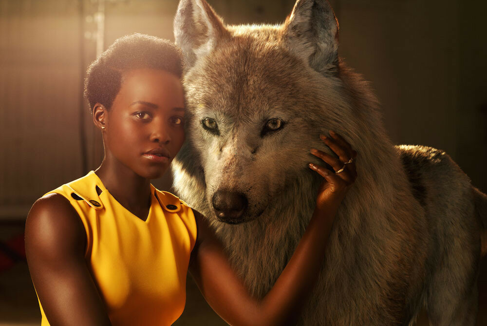 "THE JUNGLE BOOK - Lupita Nyong'o voices Raksha, a mother wolf who cares deeply for all of her pups—including man-cub Mowgli, whom she adopts as one of her own when he's abandoned in the jungle as an infant. ""She is the protector, the eternal mother,"" says Nyong'o. ""The word Raksha actually means protection in Hindi. I felt really connected to that, wanting to protect a son that isn't originally hers but one she's taken for her own.""..Photo by: Sarah Dunn. ©2016 Disney Enterprises, Inc. All Rights Reserved."