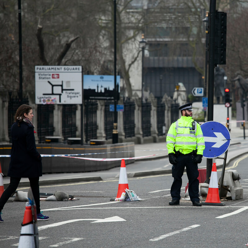 An armed police officer stands guard near Westminster Bridge and the Houses of Parliament London. After the terrorist attack