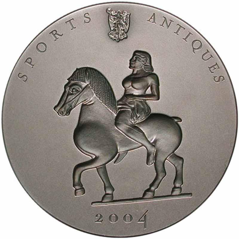 Конго, 2004 год, монета с вогнутым рисунком.jpg