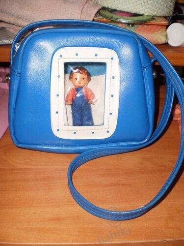 немецкий пупсик в сумочке