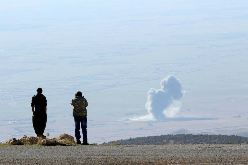 Smoke rises from the site of U.S.-led air strikes in the town of Sinjar