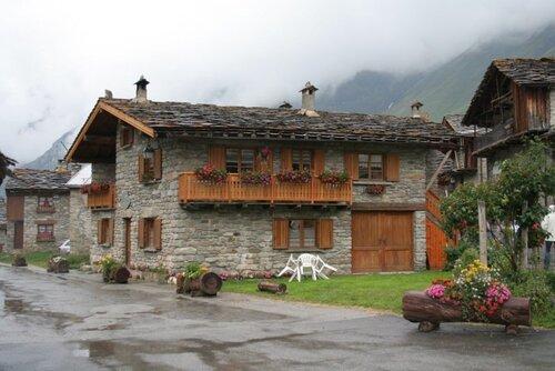 дома из камня альпы природные материалы