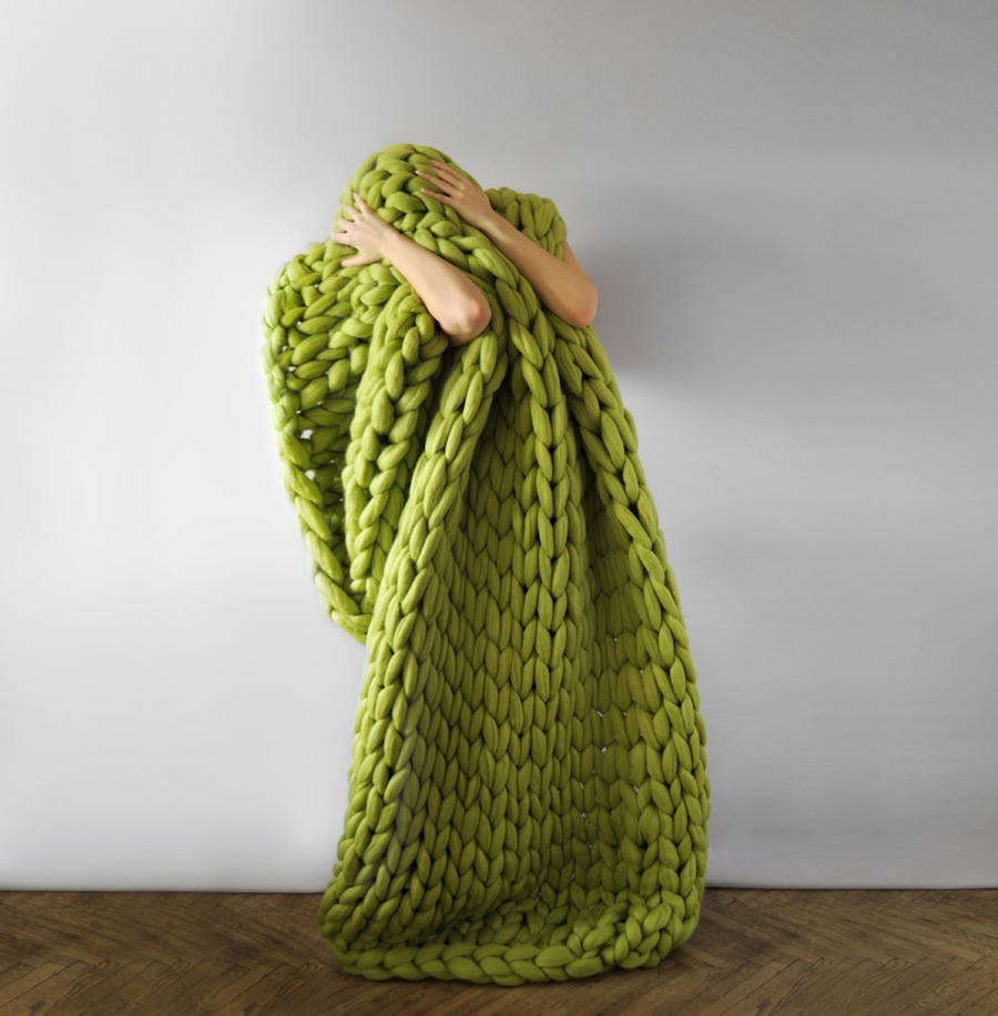 Anna Mo 's chunky knits are not shy about their pattern, the soft form of her objects forcing