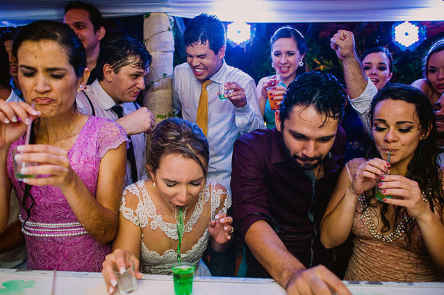 Girl is sick after taking a shot at a wedding party. (Photo by Maria Erlic/Caters News Agency/ISPWP)