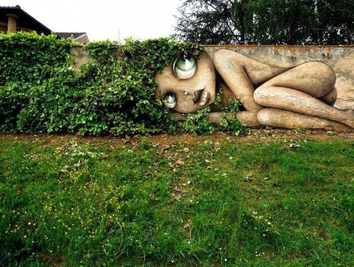 Уличный художник Vinie Graffiti.