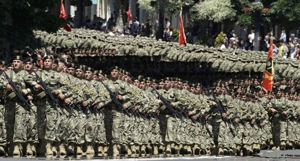 Military personnel march during a parade in Tbilisi
