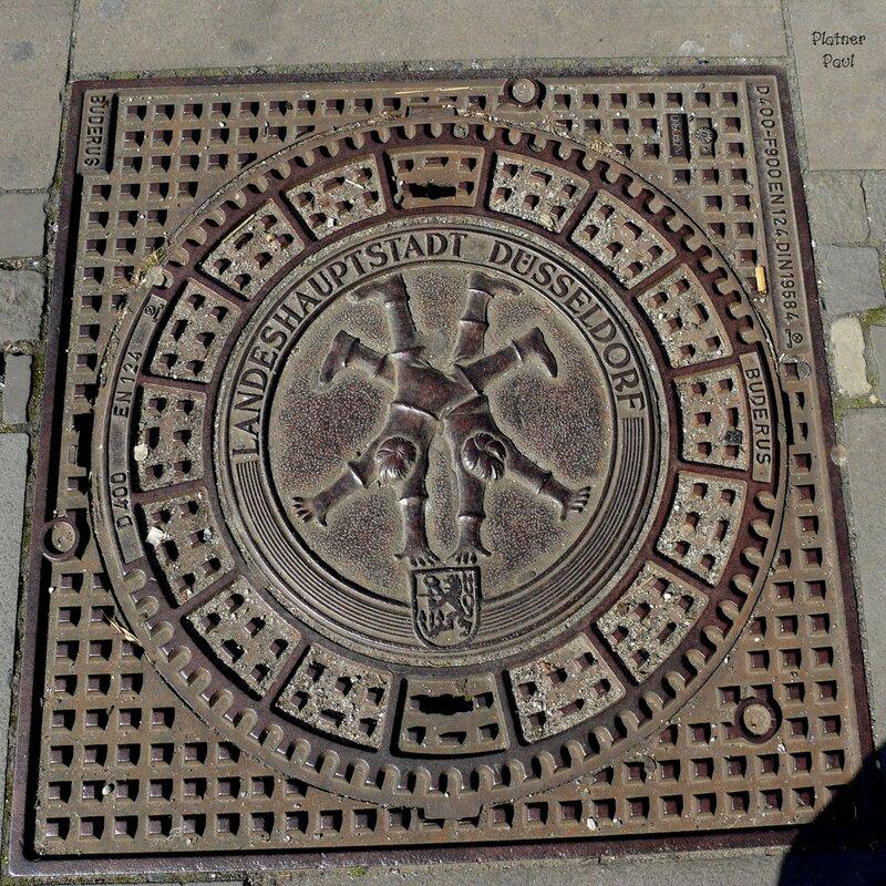 Люк ...из дюссельдорфа (Германия)и на этоом люке изображена скульптура - символ города