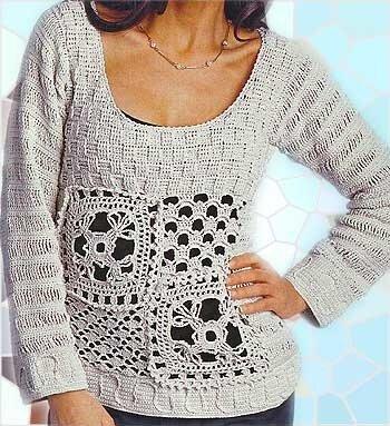 Белый пуловер с ажурной вставкой