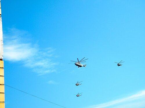 Вертолёты над городом*