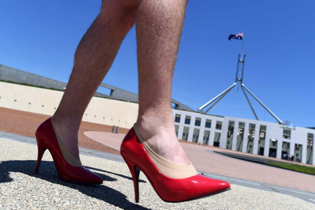 "Male bureaucrats  take part in the ""Walk a Mile in Her Shoes""campaign..jpg"