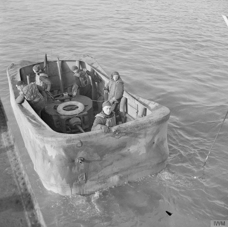 Valentine DD tank with screen erected, in the water alongside a landing craft, 79th Armoured Division School, Gosport, 14 January 1944.