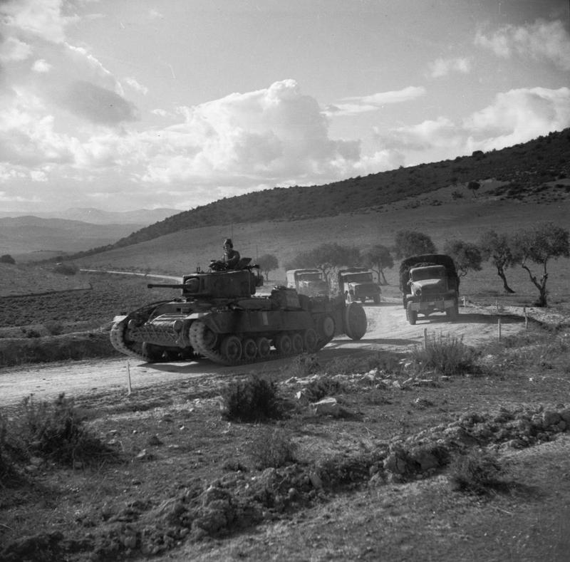 A British Valentine tank leading a supply convoy up the El Aroussa-Bou Arada road, 18-19 January 1943