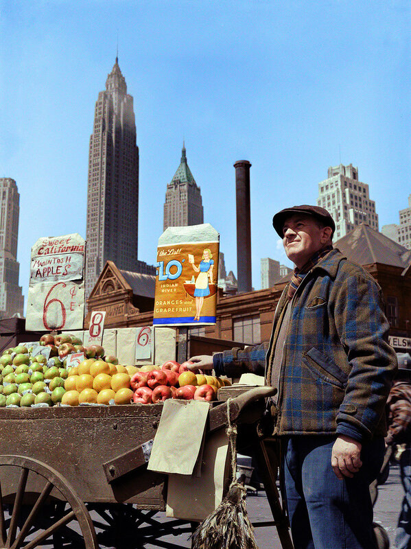 New York, May 1943. Pushcart fruit vendor at the Fulton Fish Market (colorized)