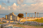 colonnade of the Ancient Greek city of Chersonese lit with the sun at sunrise, the Crimea