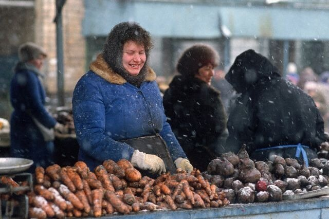 Snow Falls on Grocer at Outdoor Market in Moscow