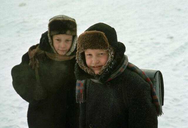 Pair of Schoolboys Travelling Home Through Snow