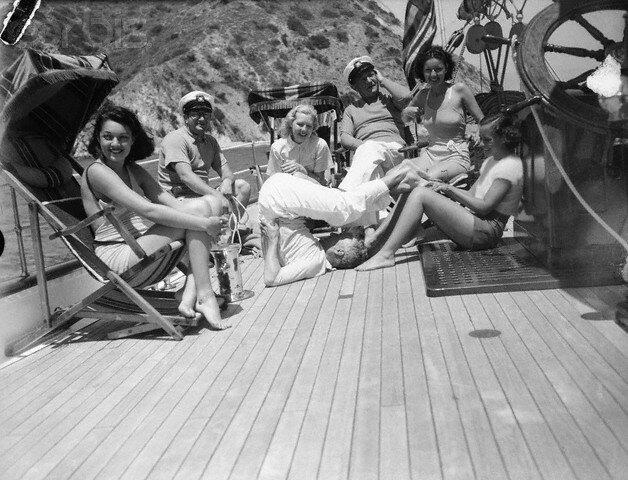 Paulette Goddard Tickling Charlie Chaplin's Feet