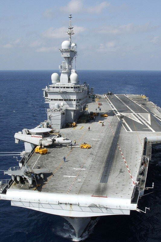 Aircraft are seen on the deck of France's flagship Charles de Gaulle aircraft carrier in the Mediterranean